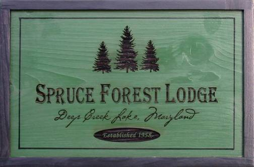cedar custom sign for camp, cabin, lodge featuring pine trees